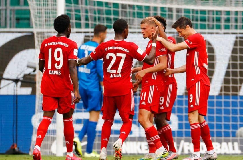 Bayern Munich players celebrating against Wolfsburg. (Photo by KAI PFAFFENBACH/POOL/AFP via Getty Images)