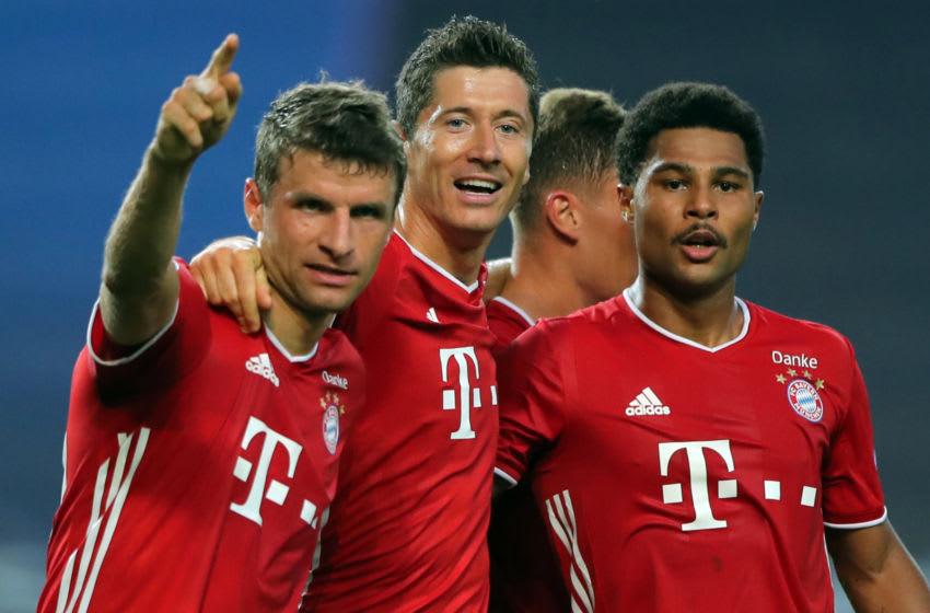 Thomas Muller, Robert Lewandowski, and Serge Gnabry, Bayern Munich. (Photo by MIGUEL A. LOPES/POOL/AFP via Getty Images)