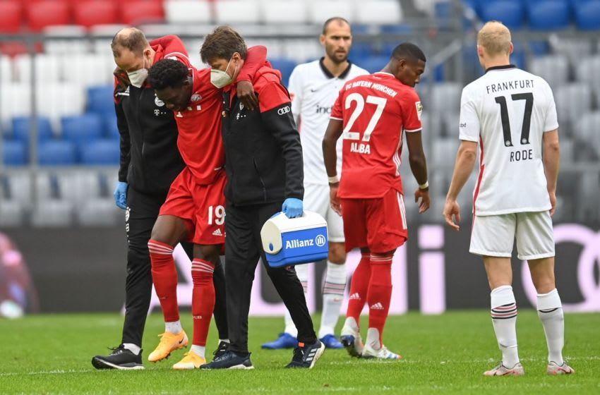 Alphonso Davies hobbling off during match between FC Bayern Munich and Eintracht Frankfurt. (Photo by CHRISTOF STACHE / various sources / AFP) / DFL REGULATIONS PROHIBIT ANY USE OF PHOTOGRAPHS AS IMAGE SEQUENCES AND/OR QUASI-VIDEO (Photo by CHRISTOF STACHE/POOL/AFP via Getty Images)