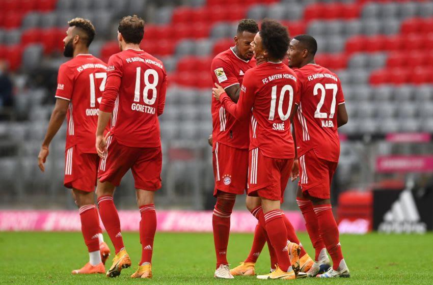 FC Bayern Munich players celebrating Leroy Sane's goal against Eintracht Frankfurt. (Photo by CHRISTOF STACHE/POOL/AFP via Getty Images)