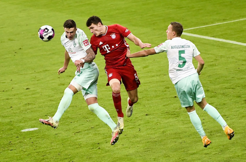 Bayern Munich defender Benjamin Pavard fighting for the ball during a tight game against Werder Bremen. (Photo by LUKAS BARTH/POOL/AFP via Getty Images)
