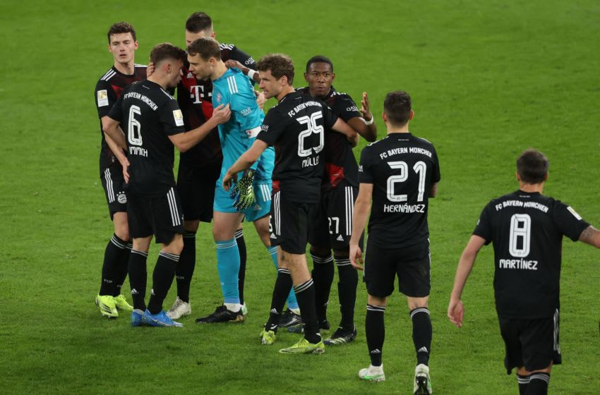 Bayern Munich players celebrating against RB Leipzig. (Photo by ALEXANDER HASSENSTEIN/POOL/AFP via Getty Images)