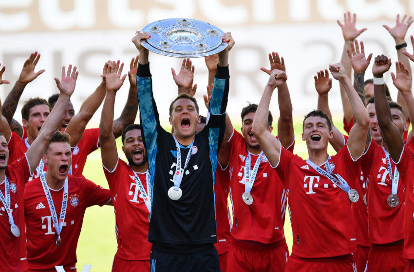 Bayern Munich players lift Bundesliga title after beating Wolfsburg. (Photo by Stuart Franklin/Getty Images)