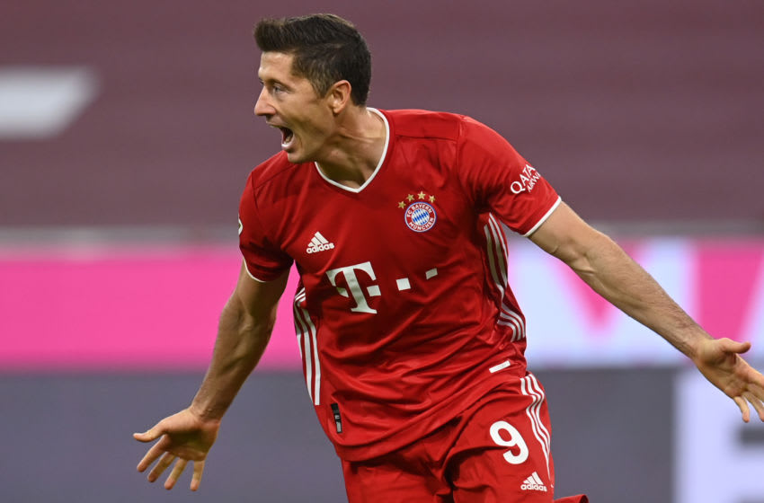 Bayern Munich's Polish forward Robert Lewandowski celebrates scoring during the German first division Bundesliga football match FC Bayern Munich vs Hertha Berlin on October 4, 2020 in Munich, southern Germany. (Photo by CHRISTOF STACHE / AFP) / DFL REGULATIONS PROHIBIT ANY USE OF PHOTOGRAPHS AS IMAGE SEQUENCES AND/OR QUASI-VIDEO (Photo by CHRISTOF STACHE/AFP via Getty Images)