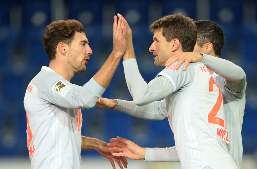 Bayern Munich's German forward Thomas Mueller (R) celebrates scoring the 0:1 goal with teammates during the German first division Bundesliga football match between DSC Arminia Bielefeld and FC Bayern Munich at the SchuecoArena in Bielefeld, western Germany, on October 17, 2020. (Photo by WOLFGANG RATTAY / POOL / AFP) / DFL REGULATIONS PROHIBIT ANY USE OF PHOTOGRAPHS AS IMAGE SEQUENCES AND/OR QUASI-VIDEO (Photo by WOLFGANG RATTAY/POOL/AFP via Getty Images)