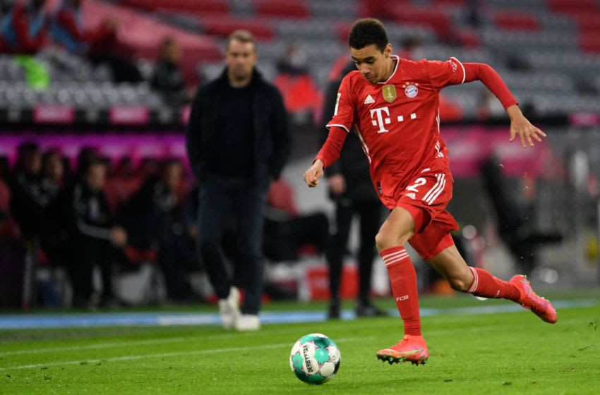 Bayern Munich's German midfielder Jamal Musiala controls the ball during the German first division Bundesliga football match FC Bayern Munich vs Bayer 04 Leverkusen in Munich, southern Germany, on April 20, 2021. - RESTRICTIONS: DFL REGULATIONS PROHIBIT ANY USE OF PHOTOGRAPHS AS IMAGE SEQUENCES AND/OR QUASI-VIDEO (Photo by ANDREAS GEBERT / various sources / AFP) / RESTRICTIONS: DFL REGULATIONS PROHIBIT ANY USE OF PHOTOGRAPHS AS IMAGE SEQUENCES AND/OR QUASI-VIDEO (Photo by ANDREAS GEBERT/AFP via Getty Images)
