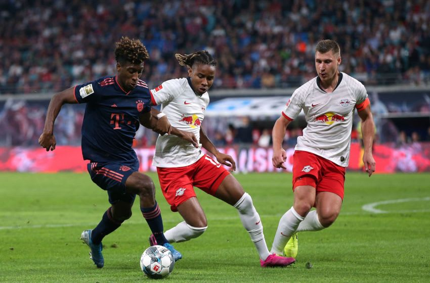 Bayern Munich's French forward Kingsley Coman (L) vies for the ball with Leipzig's French midfielder Christopher Nkunku (C) and Leipzig's German defender Willi Orban during the German first division Bundesliga football match RB Leipzig v FC Bayern Munich in Leipzig, eastern Germany on September 14, 2019. (Photo by Ronny Hartmann / AFP) / RESTRICTIONS: DFL REGULATIONS PROHIBIT ANY USE OF PHOTOGRAPHS AS IMAGE SEQUENCES AND/OR QUASI-VIDEO (Photo credit should read RONNY HARTMANN/AFP via Getty Images)