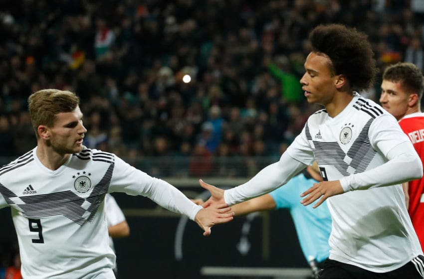 Germany's forward Leroy Sane (R) celebrates scoring the opening goal with his teammate Germany's forward Timo Werner during international friendly football match Germany v Russia in Leipzig, eastern Germany on November 15, 2018. (Photo by Odd ANDERSEN / AFP) (Photo credit should read ODD ANDERSEN/AFP via Getty Images)