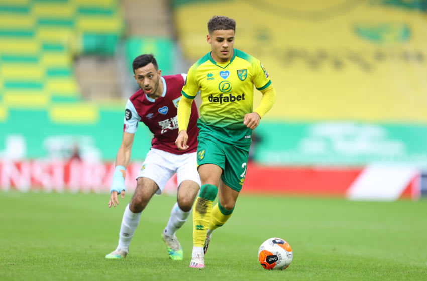 Max Aarons, Norwich City and Dwight McNeil, Burnley battle for the ball during the Premier League match between Norwich City and Burnley FC. (Photo by Julian Finney/Getty Images)