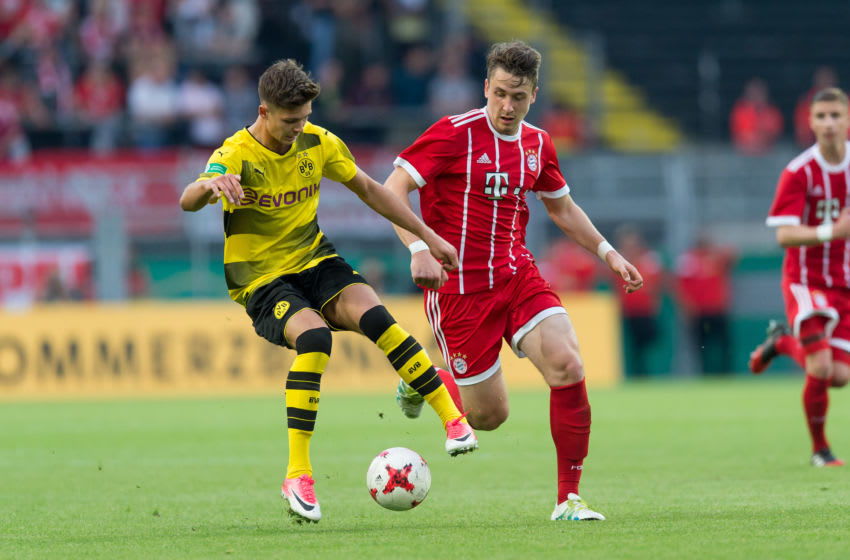 Alexander Laukart, Borussia Dortmund and Adrian Fein, Bayern Munich. (Photo by TF-Images/Getty Images)