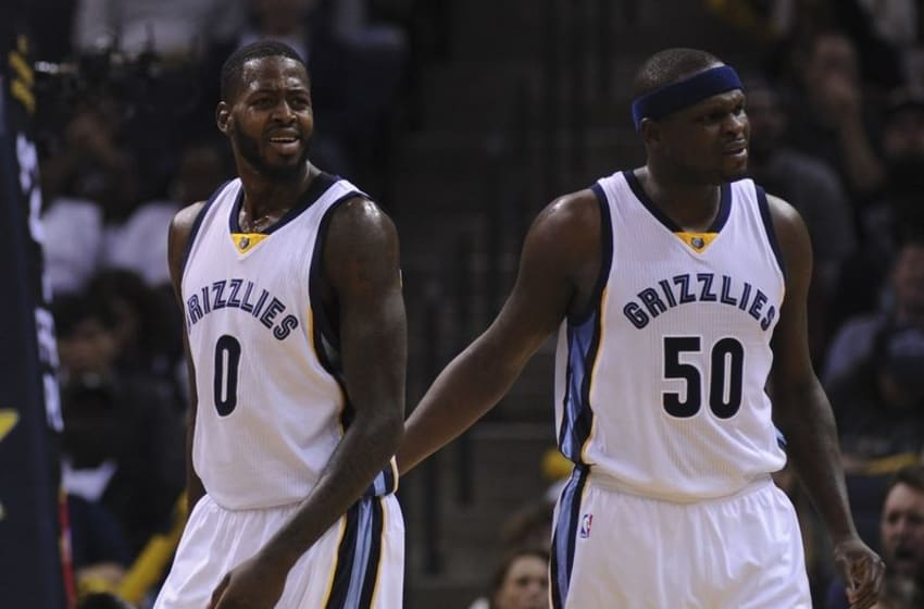 Dec 11, 2015; Memphis, TN, USA; Memphis Grizzlies forward JaMychal Green (0) and forward Zach Randolph (50) react during the second quarter against the Charlotte Hornets at FedExForum. Mandatory Credit: Justin Ford-USA TODAY Sports