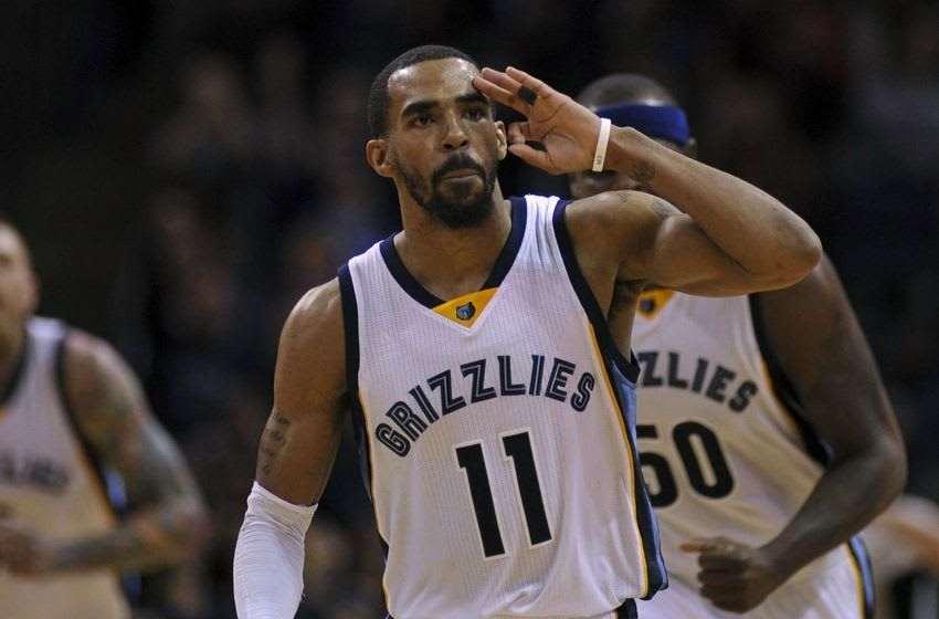 Mar 2, 2016; Memphis, TN, USA; Memphis Grizzlies guard Mike Conley (11) celebrates against the Sacramento Kings during the second half at FedExForum. Memphis Grizzlies defeated Sacramento Kings 104-98. Mandatory Credit: Justin Ford-USA TODAY Sports