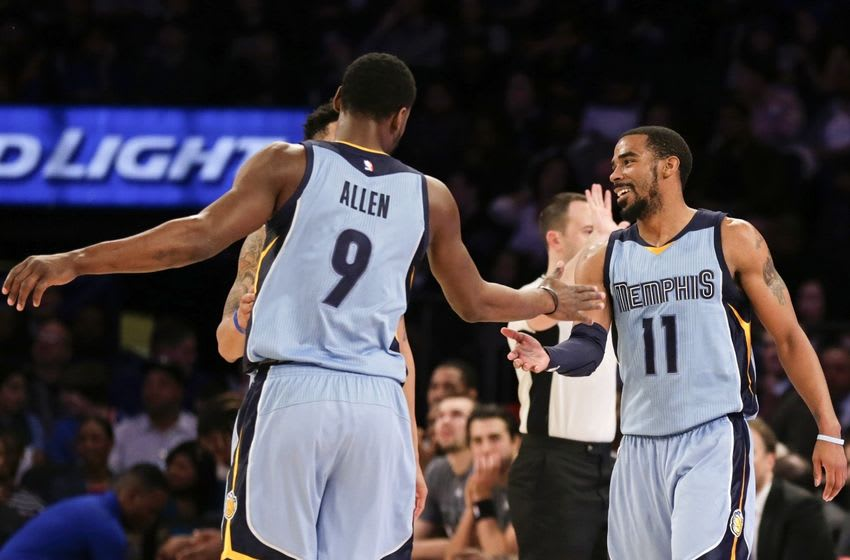 Feb 5, 2016; New York, NY, USA; Memphis Grizzlies guard Mike Conley (11) celebrates with Tony Allen (9) against the New York Knicks during the second half at Madison Square Garden. The Grizzlies defeated the Knicks 91-85. Mandatory Credit: Adam Hunger-USA TODAY Sports