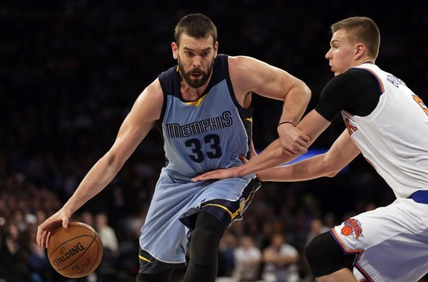Feb 5, 2016; New York, NY, USA; Memphis Grizzlies center Marc Gasol (33) drives to the basket past New York Knicks forward Kristaps Porzingis (6) during the first half at Madison Square Garden. Mandatory Credit: Adam Hunger-USA TODAY Sports