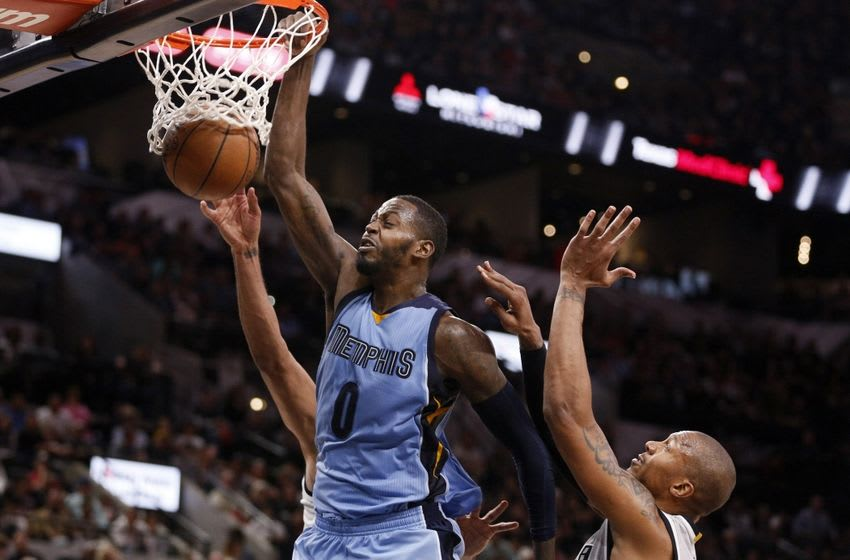 Mar 25, 2016; San Antonio, TX, USA; Memphis Grizzlies power forward JaMychal Green (0) dunks the ball pas San Antonio Spurs power forward Tim Duncan (21, left) and David West (30, right) during the second half at AT&T Center. Mandatory Credit: Soobum Im-USA TODAY Sports