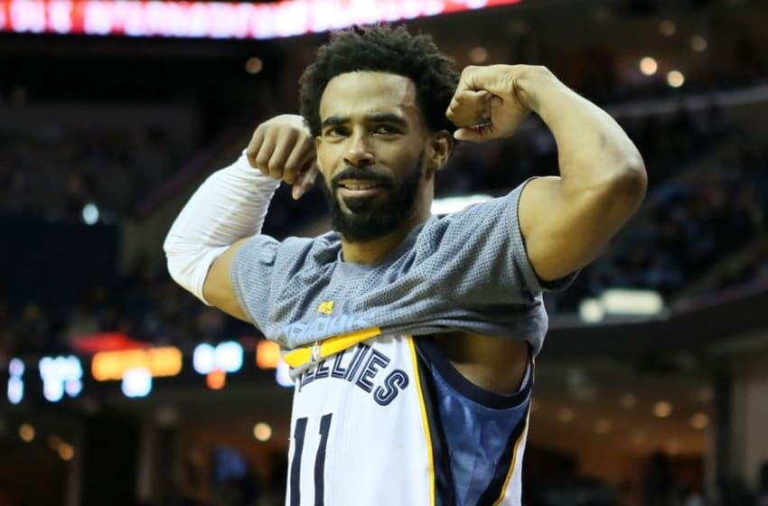 Nov 28, 2016; Memphis, TN, USA; Memphis Grizzlies guard Mike Conley (11) celebrates from the bench after a score against the Charlotte Hornets in the second quarter at FedExForum. Mandatory Credit: Nelson Chenault-USA TODAY Sports