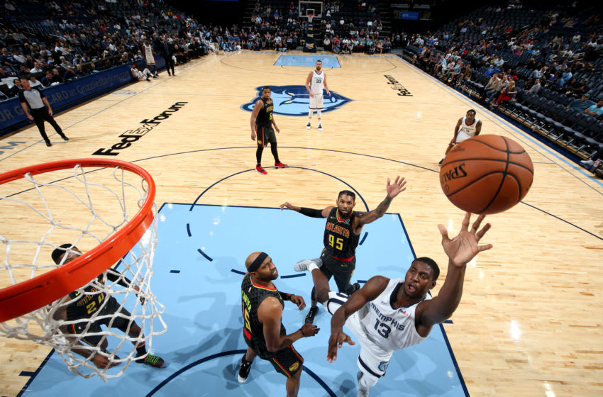 MEMPHIS, TN - OCTOBER 5: Jaren Jackson Jr. #13 of the Memphis Grizzlies shoots the ball against the Atlanta Hawks on October 5, 2018 at FedExForum in Memphis, Tennessee. NOTE TO USER: User expressly acknowledges and agrees that, by downloading and or using this photograph, User is consenting to the terms and conditions of the Getty Images License Agreement. Mandatory Copyright Notice: Copyright 2018 NBAE (Photo by Joe Murphy/NBAE via Getty Images)