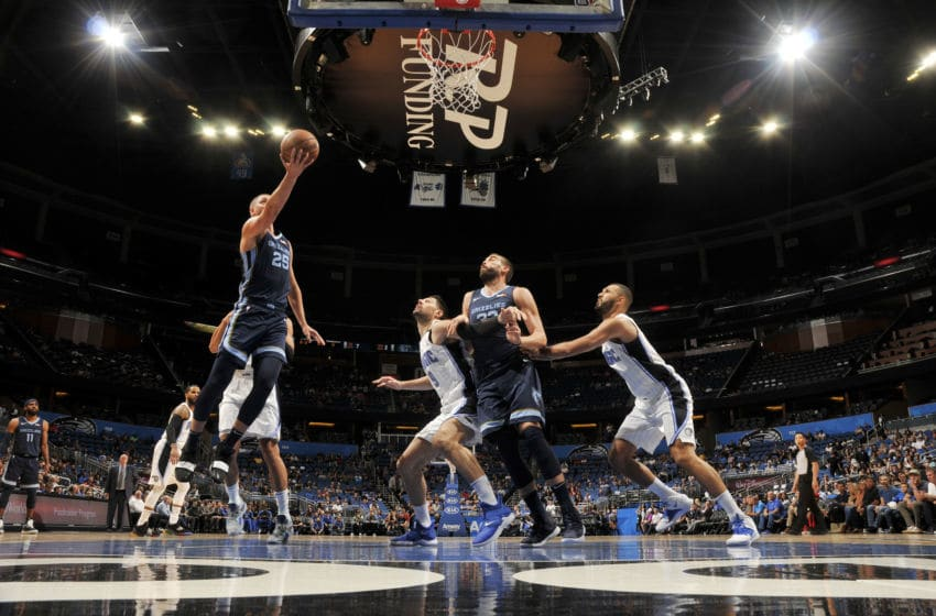 ORLANDO, FL - OCTOBER 10: Chandler Parsons #25 of the Memphis Grizzlies shoots the ball against the Orlando Magic during a pre-season game on October 10, 2018 at Amway Center in Orlando, Florida. NOTE TO USER: User expressly acknowledges and agrees that, by downloading and or using this photograph, User is consenting to the terms and conditions of the Getty Images License Agreement. Mandatory Copyright Notice: Copyright 2018 NBAE (Photo by Fernando Medina/NBAE via Getty Images)