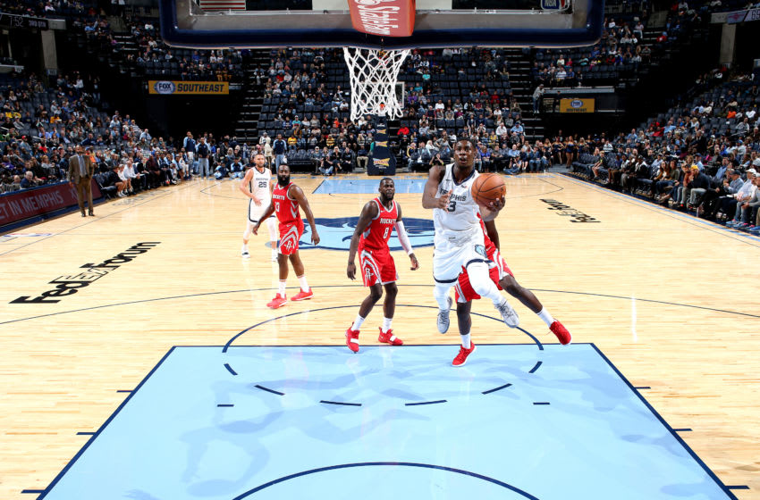 MEMPHIS, TN - OCTOBER 12: Jaren Jackson Jr. #13 of the Memphis Grizzlies shoots the ball against the Houston Rockets during a pre-season game on October 12, 2018 at FedExForum in Memphis, Tennessee. NOTE TO USER: User expressly acknowledges and agrees that, by downloading and or using this photograph, User is consenting to the terms and conditions of the Getty Images License Agreement. Mandatory Copyright Notice: Copyright 2018 NBAE (Photo by Joe Murphy/NBAE via Getty Images)