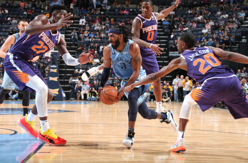 MEMPHIS, TN - OCTOBER 27: Mike Conley #11 of the Memphis Grizzlies drives to the basket against the Phoenix Suns on October 27, 2018 at FedExForum in Memphis, Tennessee. NOTE TO USER: User expressly acknowledges and agrees that, by downloading and/or using this photograph, user is consenting to the terms and conditions of the Getty Images License Agreement. Mandatory Copyright Notice: Copyright 2018 NBAE (Photo by Ned Dishman/NBAE via Getty Images)