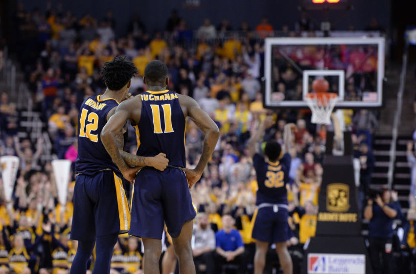 EVANSVILLE, IN - MARCH 09: Murray State Racers Guard Ja Morant (12) and Murray State Racers Guard Shaq Buchanan (11) looks on as Murray State Racers Forward Darnell Cowart (32) shoots a free throw in the final seconds of the Ohio Valley Conference (OVC) Championship college basketball game between the Murray State Racers and the Belmont Bruins on March 9, 2019, at the Ford Center in Evansville, Indiana. (Photo by Michael Allio/Icon Sportswire via Getty Images)
