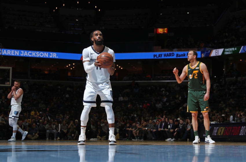 MEMPHIS, TN - MARCH 8: Mike Conley #11 of the Memphis Grizzlies shoots the ball against the Utah Jazz on March 8, 2019 at FedExForum in Memphis, Tennessee. NOTE TO USER: User expressly acknowledges and agrees that, by downloading and or using this photograph, User is consenting to the terms and conditions of the Getty Images License Agreement. Mandatory Copyright Notice: Copyright 2019 NBAE (Photo by Joe Murphy/NBAE via Getty Images)