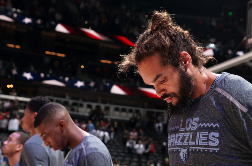 ATLANTA, GA - MARCH 13: Joakim Noah #55 of the Memphis Grizzlies stands for the national anthem before the game against the Atlanta Hawks on March 13, 2019 at State Farm Arena in Atlanta, Georgia. NOTE TO USER: User expressly acknowledges and agrees that, by downloading and/or using this Photograph, user is consenting to the terms and conditions of the Getty Images License Agreement. Mandatory Copyright Notice: Copyright 2019 NBAE (Photo by Jasear Thompson/NBAE via Getty Images)