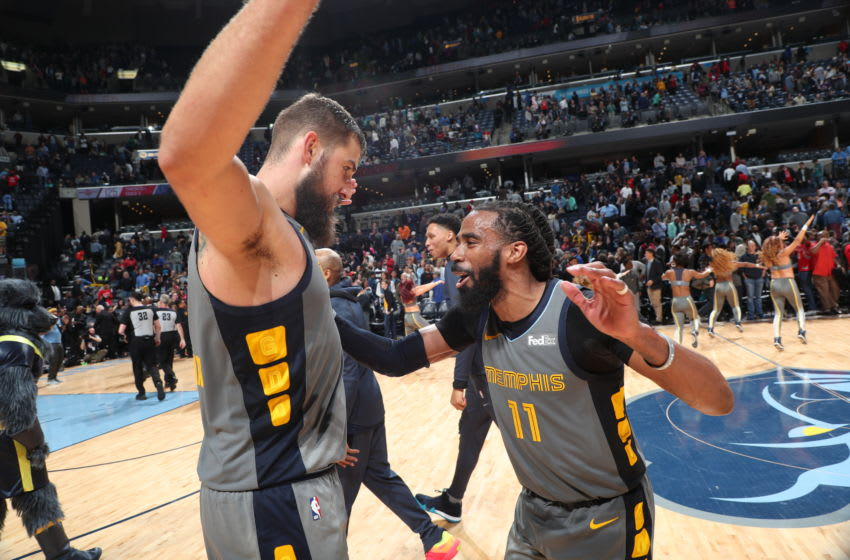 MEMPHIS, TN - MARCH 20: Jonas Valanciunas #17 and Mike Conley #11 of the Memphis Grizzlies react after the game against the Houston Rockets on March 20, 2019 at FedExForum in Memphis, Tennessee. NOTE TO USER: User expressly acknowledges and agrees that, by downloading and or using this photograph, User is consenting to the terms and conditions of the Getty Images License Agreement. Mandatory Copyright Notice: Copyright 2019 NBAE (Photo by Joe Murphy/NBAE via Getty Images)
