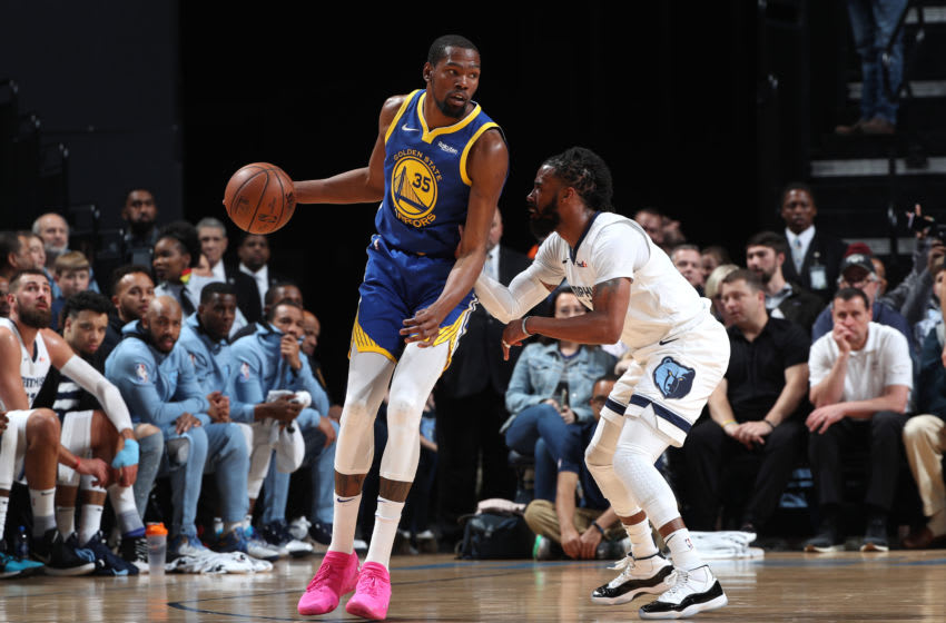 MEMPHIS, TN - MARCH 27: Kevin Durant #35 of the Golden State Warriors posts up on Mike Conley #11 of the Memphis Grizzlies on March 27, 2019 at FedExForum in Memphis, Tennessee. NOTE TO USER: User expressly acknowledges and agrees that, by downloading and or using this photograph, User is consenting to the terms and conditions of the Getty Images License Agreement. Mandatory Copyright Notice: Copyright 2019 NBAE (Photo by Joe Murphy/NBAE via Getty Images)