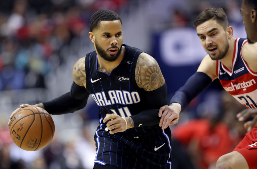 WASHINGTON, DC - MARCH 13: D.J. Augustin #14 of the Orlando Magic drives against Tomas Satoransky #31 of the Washington Wizards in the first half at Capital One Arena on March 13, 2019 in Washington, DC. NOTE TO USER: User expressly acknowledges and agrees that, by downloading and or using this photograph, User is consenting to the terms and conditions of the Getty Images License Agreement. (Photo by Rob Carr/Getty Images)