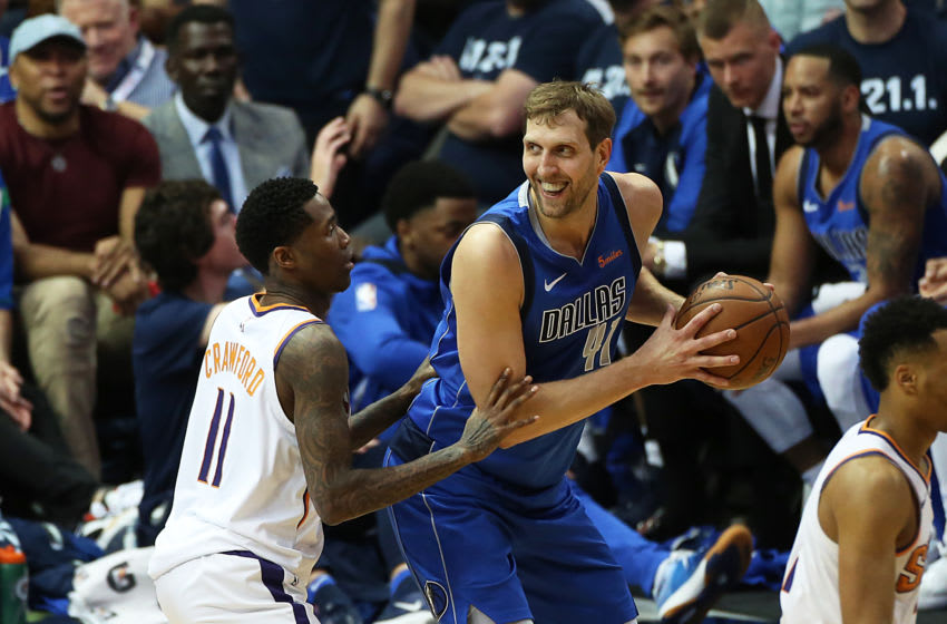 DALLAS, TX - APRIL 09: Dirk Nowitzki #41 of the Dallas Mavericks posts up on Jamal Crawford #11 of the Phoenix Suns during the game between Phoenix Suns and Dallas Mavericks at American Airlines Center on April 9, 2019 in Dallas, Texas. NOTE TO USER: User expressly acknowledges and agrees that, by downloading and or using this photograph, User is consenting to the terms and conditions of the Getty Images License Agreement. (Photo by Omar Vega/Getty Images)