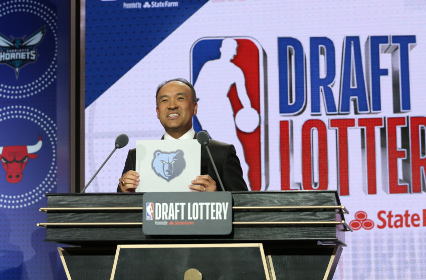 CHICAGO, IL - MAY 14: Deputy Commissioner of the NBA, Mark Tatum, holds up the card for the Memphis Grizzlies after they get the 2nd overall pick in the NBA Draft during the 2019 NBA Draft Lottery on May 14, 2019 at the Chicago Hilton in Chicago, Illinois. NOTE TO USER: User expressly acknowledges and agrees that, by downloading and/or using this photograph, user is consenting to the terms and conditions of the Getty Images License Agreement. Mandatory Copyright Notice: Copyright 2019 NBAE (Photo by Gary Dineen/NBAE via Getty Images)