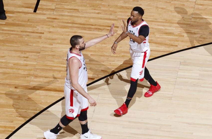 TORONTO, CANADA - MAY 25: Marc Gasol #33 and Norman Powell #24 of the Toronto Raptors high five during Game Six of the Eastern Conference Finals against the Milwaukee Bucks on May 25, 2019 at Scotiabank Arena in Toronto, Ontario, Canada. NOTE TO USER: User expressly acknowledges and agrees that, by downloading and/or using this photograph, user is consenting to the terms and conditions of the Getty Images License Agreement. Mandatory Copyright Notice: Copyright 2019 NBAE (Photo by Mark Blinch/NBAE via Getty Images)