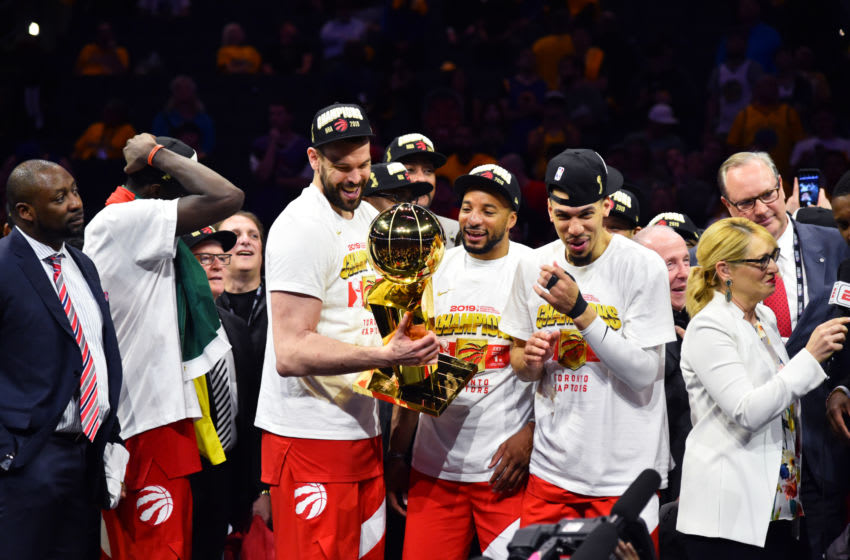 OAKLAND, CA - JUNE 13: The Toronto Raptors celebrate after winning the 2019 NBA Championship against the Golden State Warriors after Game Six of the NBA Finals on June 13, 2019 at ORACLE Arena in Oakland, California. NOTE TO USER: User expressly acknowledges and agrees that, by downloading and/or using this photograph, user is consenting to the terms and conditions of Getty Images License Agreement. Mandatory Copyright Notice: Copyright 2019 NBAE (Photo by Jesse D. Garrabrant/NBAE via Getty Images)