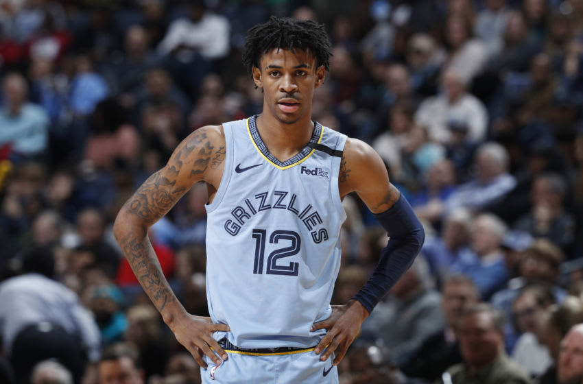 MEMPHIS, TN - JANUARY 26: Ja Morant #12 of the Memphis Grizzlies looks on during a game against the Phoenix Suns at FedExForum on January 26, 2020 in Memphis, Tennessee. The Grizzlies defeated the Suns 114-109. NOTE TO USER: User expressly acknowledges and agrees that, by downloading and or using this Photograph, user is consenting to the terms and conditions of the Getty Images License Agreement. (Photo by Joe Robbins/Getty Images)