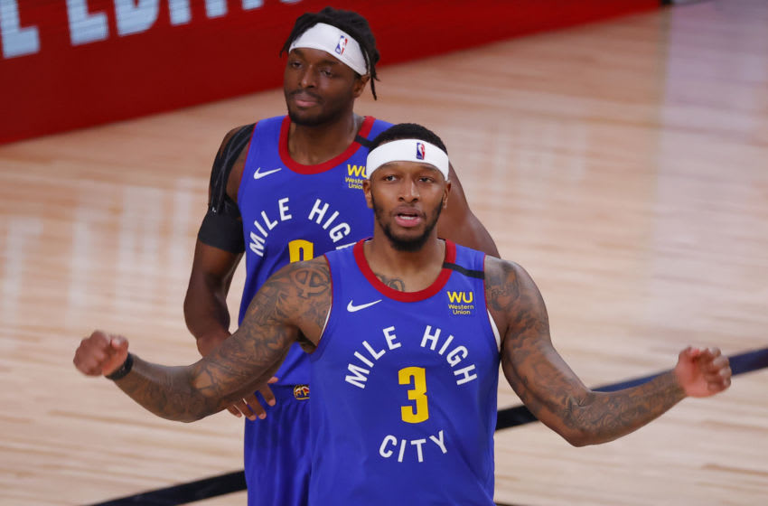 LAKE BUENA VISTA, FLORIDA - AUGUST 23: Torrey Craig #3 and Jerami Grant #9 of the Denver Nuggets react after a foul was called during the second quarter against the Utah Jazz in Game Four of the Western Conference First Round during the 2020 NBA Playoffs at AdventHealth Arena at ESPN Wide World Of Sports Complex on August 23, 2020 in Lake Buena Vista, Florida. NOTE TO USER: User expressly acknowledges and agrees that, by downloading and or using this photograph, User is consenting to the terms and conditions of the Getty Images License Agreement. (Photo by Kevin C. Cox/Getty Images)