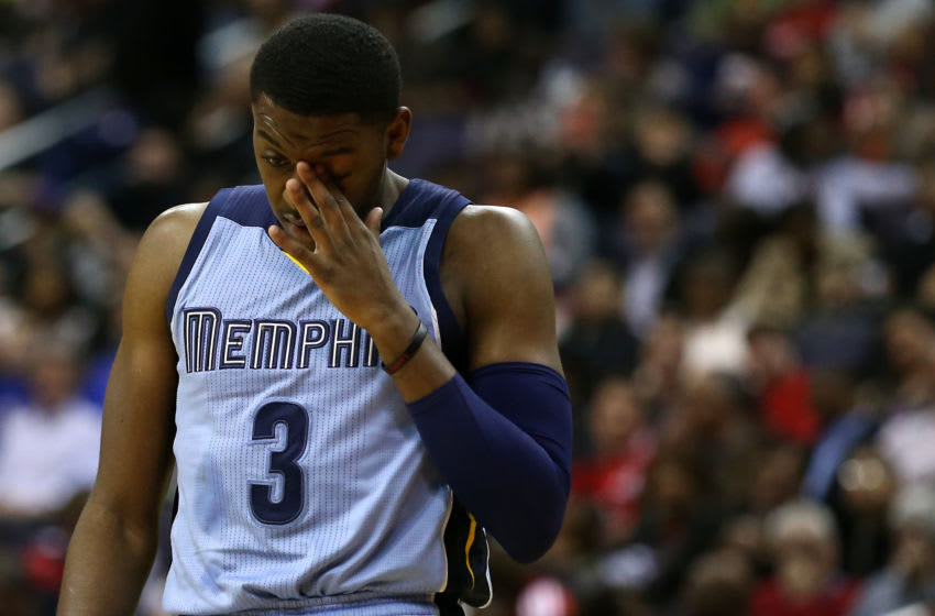 WASHINGTON, DC - MARCH 12: Jordan Adams #3 of the Memphis Grizzlies wipes his face after being attended to following being fouled against the Washington Wizards in the first half at Verizon Center on March 12, 2015 in Washington, DC. NOTE TO USER: User expressly acknowledges and agrees that, by downloading and or using this photograph, User is consenting to the terms and conditions of the Getty Images License Agreement. (Photo by Patrick Smith/Getty Images)
