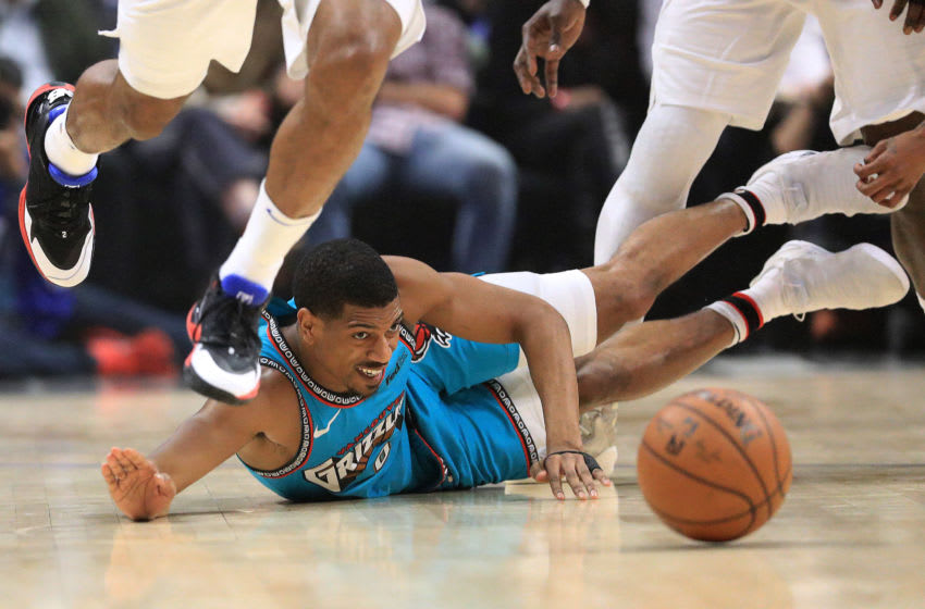 LOS ANGELES, CALIFORNIA - FEBRUARY 24: De'Anthony Melton #0 of the Memphis Grizzlies lunges for a loose ball during the first half of a game against the Los Angeles Clippers at Staples Center on February 24, 2020 in Los Angeles, California. NOTE TO USER: User expressly acknowledges and agrees that, by downloading and/or using this photograph, user is consenting to the terms and conditions of the Getty Images License Agreement. (Photo by Sean M. Haffey/Getty Images)