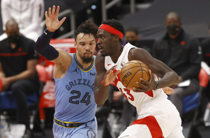 May 8, 2021; Tampa, Florida, USA; Toronto Raptors forward Pascal Siakam (43) drives to the basket against Memphis Grizzlies forward Dillon Brooks (24) during the second half at Amalie Arena. Mandatory Credit: Kim Klement-USA TODAY Sports