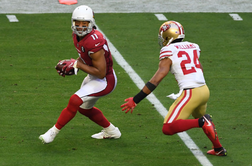 GLENDALE, ARIZONA - DECEMBER 26: Wide receiver Larry Fitzgerald #11 of the Arizona Cardinals catches a pass as cornerback K'Waun Williams #24 of the San Francisco 49ers gives chase during the first half at State Farm Stadium on December 26, 2020 in Glendale, Arizona. (Photo by Norm Hall/Getty Images)