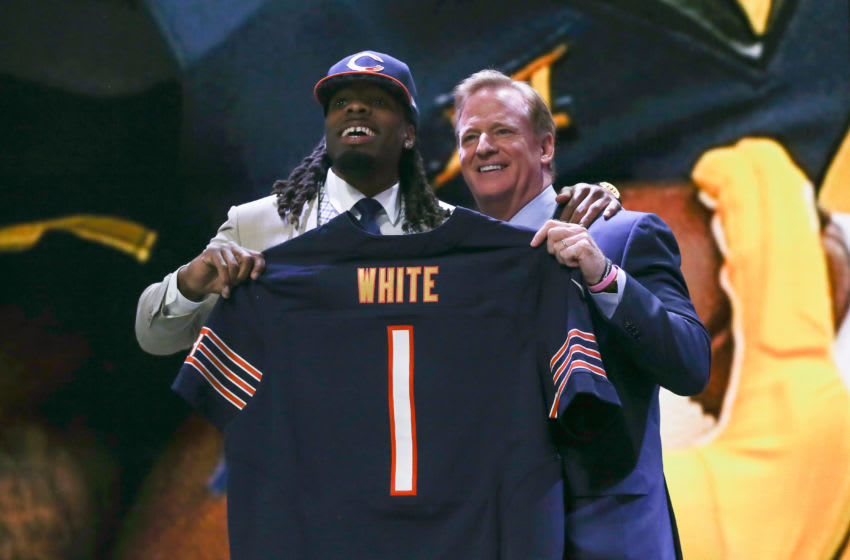 CHICAGO, IL - APRIL 30: Kevin White of the West Virginia Mountaineers holds up a jersey with NFL Commissioner Roger Goodell after being chosen
