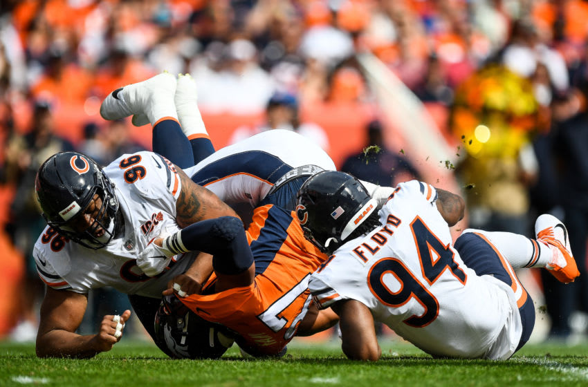 DENVER, CO - SEPTEMBER 15: Noah Fant #87 of the Denver Broncos is tackled by Leonard Floyd #94 and Akiem Hicks #96 of the Chicago Bears in the first quarter of a game at Empower Field at Mile High on September 15, 2019 in Denver, Colorado. (Photo by Dustin Bradford/Getty Images)