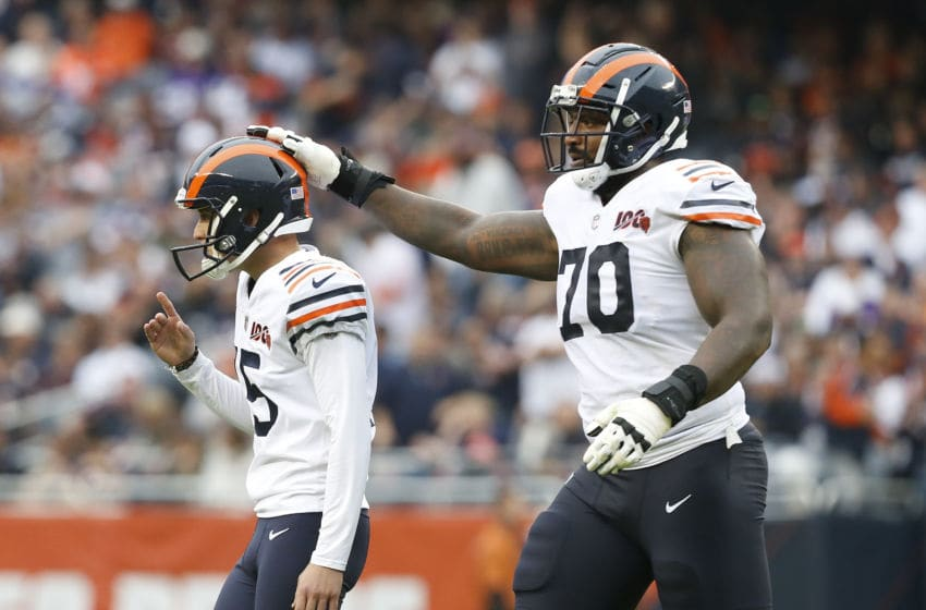 CHICAGO, ILLINOIS - SEPTEMBER 29: Bobby Massie #70 of the Chicago Bears congratulates Eddy Pineiro #15 following his field goal during the second half against the Minnesota Vikings at Soldier Field on September 29, 2019 in Chicago, Illinois. (Photo by Nuccio DiNuzzo/Getty Images)