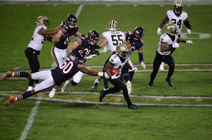 CHICAGO, ILLINOIS - NOVEMBER 01: Deonte Harris #11 of the New Orleans Saints runs the ball past Barkevious Mingo #50 of the Chicago Bears in the second half at Soldier Field on November 01, 2020 in Chicago, Illinois. (Photo by Jonathan Daniel/Getty Images)