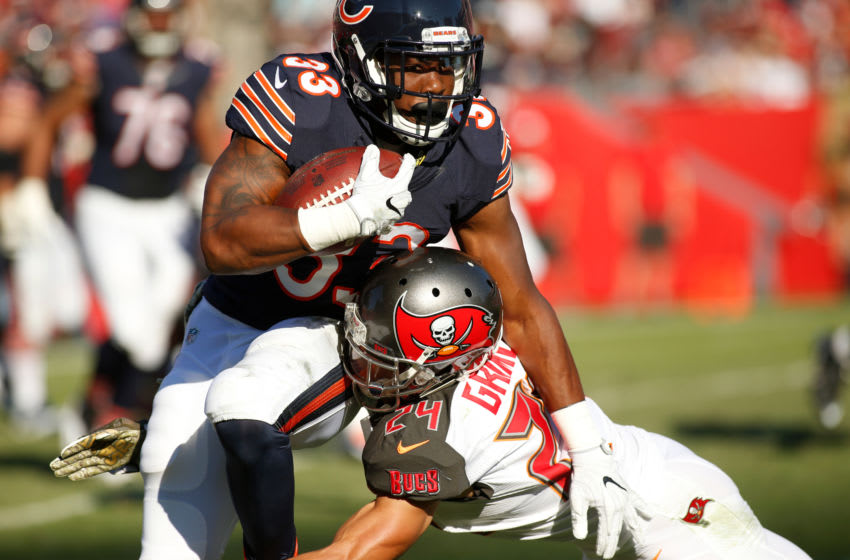 TAMPA, FL - NOVEMBER 13: Running back Jeremy Langford #33 of the Chicago Bears is stopped by cornerback Brent Grimes #24 of the Tampa Bay Buccaneers during a carry in the third quarter of an NFL game on November 13, 2016 at Raymond James Stadium in Tampa, Florida. (Photo by Brian Blanco/Getty Images)
