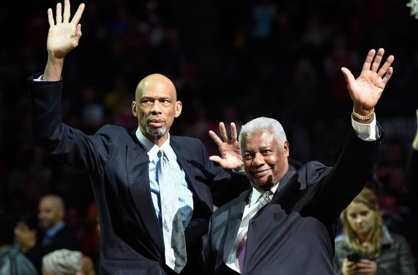 Nov 7, 2015; Milwaukee, WI, USA; Former Milwaukee Bucks Kareem Abdul-Jabbar (left) and Oscar Robertson waves to fans before game against the Brooklyn Nets while promoting the new team arena at BMO Harris Bradley Center. Mandatory Credit: Benny Sieu-USA TODAY Sports
