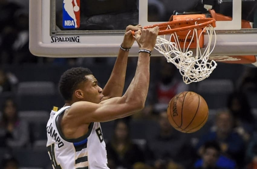 Oct 15, 2016; Milwaukee, WI, USA; Milwaukee Bucks forward Giannis Antetokounmpo (34) dunks a basket in the second quarter during the game against the Chicago Bulls at BMO Harris Bradley Center. Mandatory Credit: Benny Sieu-USA TODAY Sports