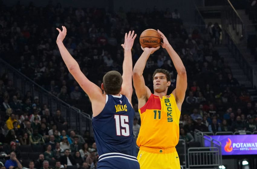 MILWAUKEE, WISCONSIN - NOVEMBER 19: Brook Lopez #11 of the Milwaukee Bucks shoots over Nikola Jokic #15 of the Denver Nuggets during the first half of a game at Fiserv Forum on November 19, 2018 in Milwaukee, Wisconsin. NOTE TO USER: User expressly acknowledges and agrees that, by downloading and or using this photograph, User is consenting to the terms and conditions of the Getty Images License Agreement. (Photo by Stacy Revere/Getty Images)