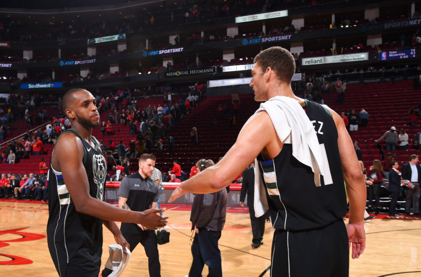 HOUSTON, TX - JANUARY 9 : Khris Middleton #22 hi-fives Brook Lopez #11 of the Milwaukee Bucks after the game against the Houston Rockets on January 9, 2019 at the Toyota Center in Houston, Texas. NOTE TO USER: User expressly acknowledges and agrees that, by downloading and or using this photograph, User is consenting to the terms and conditions of the Getty Images License Agreement. Mandatory Copyright Notice: Copyright 2019 NBAE (Photo by Bill Baptist/NBAE via Getty Images)