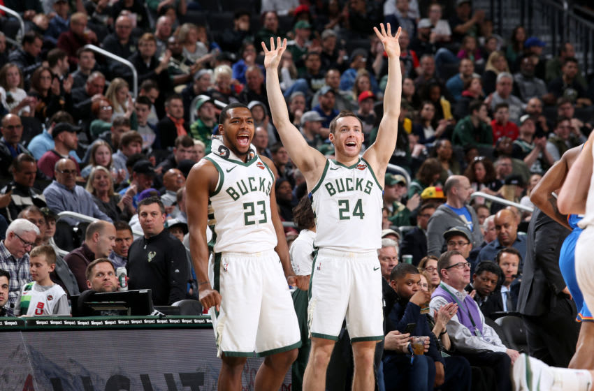 MILWAUKEE, WI - APRIL 10: Sterling Brown #23 and Pat Connaughton #24 of the Milwaukee Bucks react to a play during the game against the Oklahoma City Thunder on April 10, 2019 at the Fiserv Forum in Milwaukee, Wisconsin. NOTE TO USER: User expressly acknowledges and agrees that, by downloading and/or using this photograph, user is consenting to the terms and conditions of the Getty Images License Agreement. Mandatory Copyright Notice: Copyright 2019 NBAE (Photo by Gary Dineen/NBAE via Getty Images)